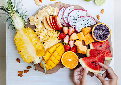 Colorful tropical fruits on serving tray
